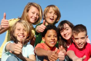 bigstock-happy-kids-with-thumbs-up