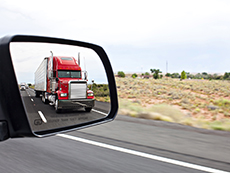 Semi truck as seen in passenger car side view mirrorPlease see similar images in my portfolio: